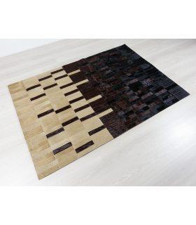 Alfombra de Piel diseñada por cliente. Colores Negro, Marrón y Beig.
