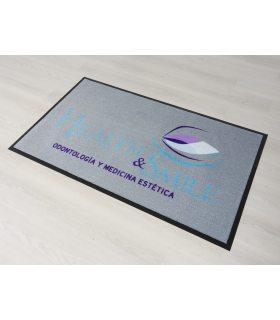 Felpudo Logo EST personalizado para clínica dental.