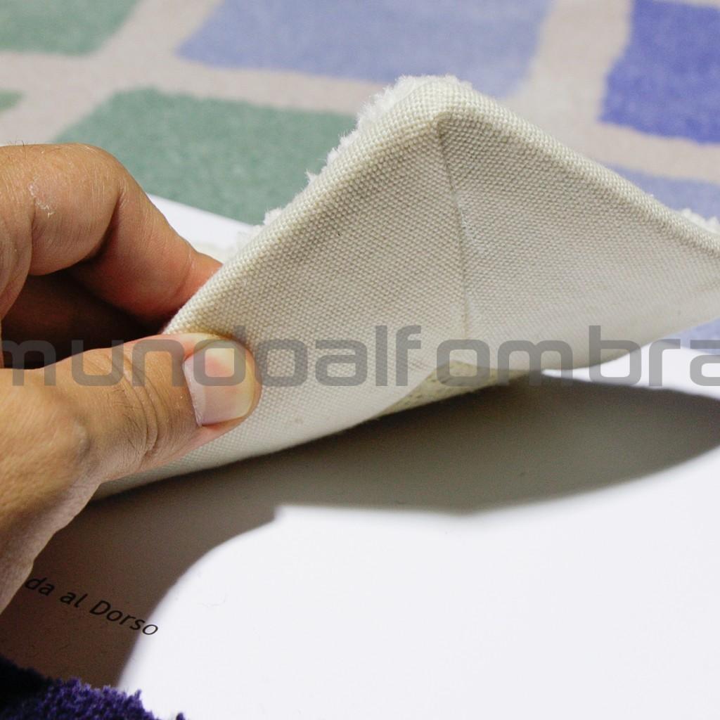 alfombra de lana a medida con cinta de borde cosida y pegada a la base