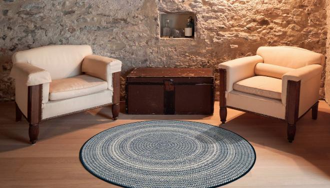 Nuestra alfombra redonda para exteriores e interiores ALBIR 37. Imita a las alfombras de cuerda de yute y está disponible en tres colores.